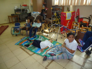 Mats made from plastic bags delivered to handicapped children