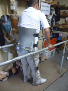 Back brace with orthotic legs.